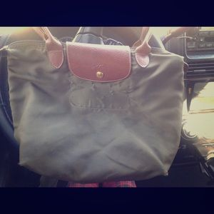Green Longchamp Le Pliage with light wear